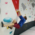 Andy bouldering with some style on an overhanging problem