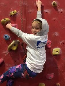 Team climber Evie Bramley climbing.