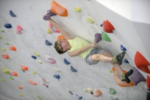 Oscar bouldering on a steep overhanging indoor wall