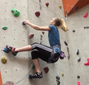 Olivia on 6b+ route at Reading Climbing Wall