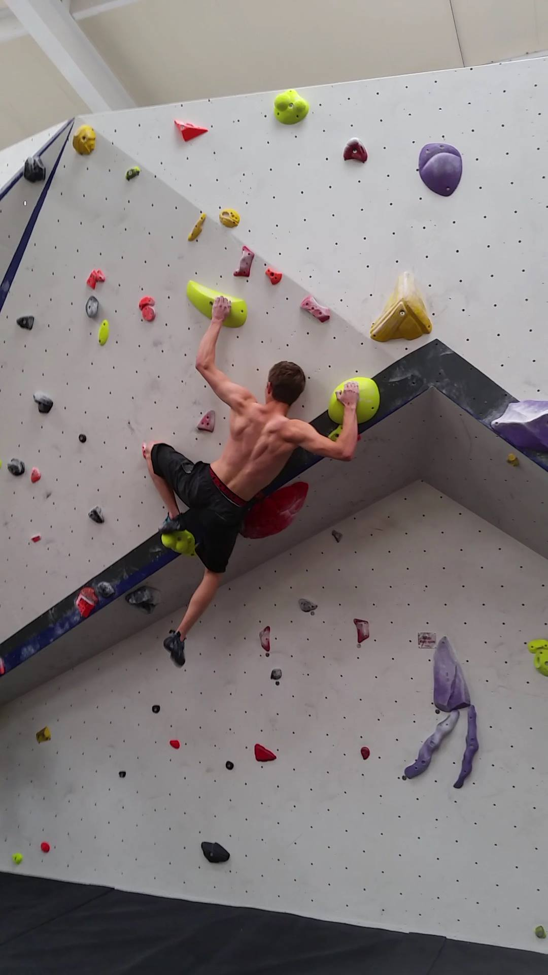 Climbing Shoulder Injuries can happen easily. Climber on a boulder problem with highly activated shoulders.
