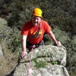 Climber finishing a Trad Climbing route