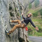 Climber doing the star performer act on a rock climb