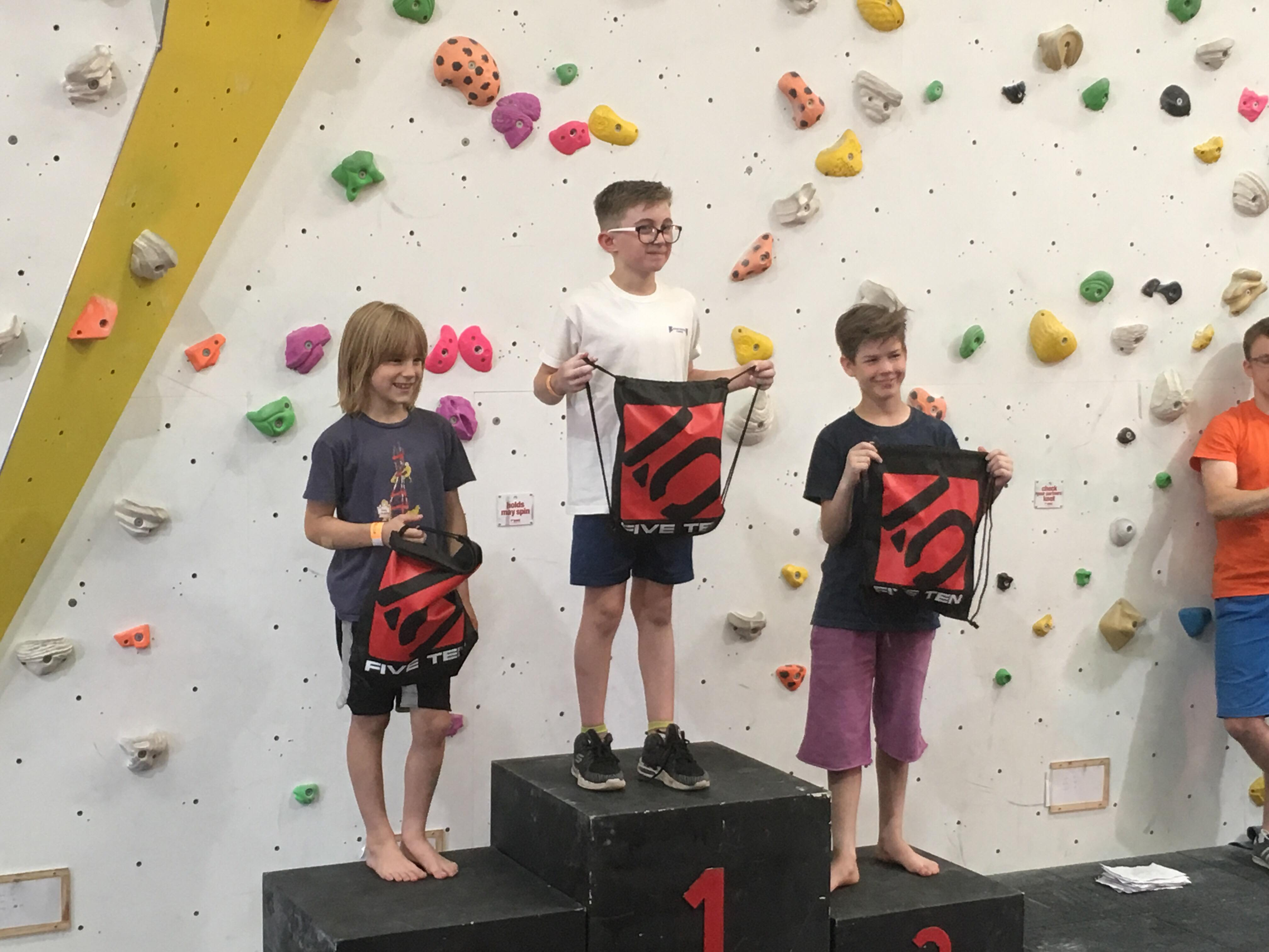 Oscar Preston takes 1st place on the podium at the Southern Youth Bouldering Championships