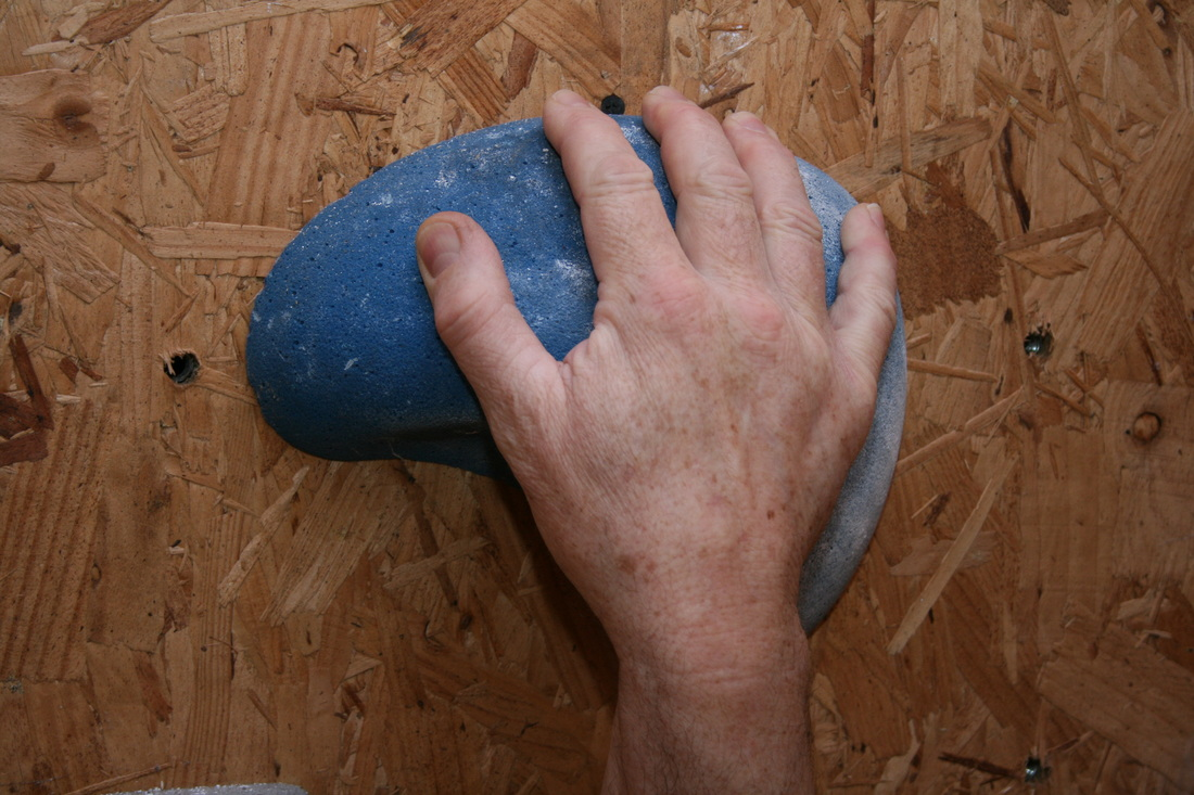 Open fingers on a large rounded sloper.