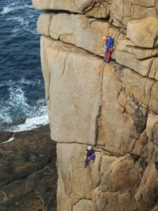 Cornwall Climbing. Dan Bow and Katia McCrudden on Demo Route, Sennen Cove, Cornwall.
